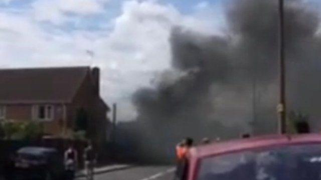 Smoke billowing over crash scene