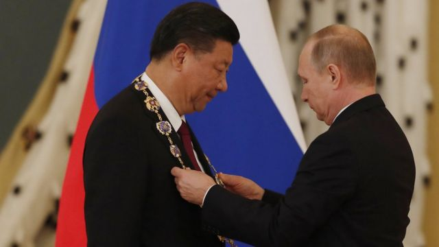 Russian President Vladimir Putin (R) decorates Chinese President Xi Jinping (R) with the Order of St. Andrew the Apostle the First-Called during their meeting in the Kremlin in Moscow, Russia, 04 July 2017. Chinese President is on a two-days official visit in Moscow