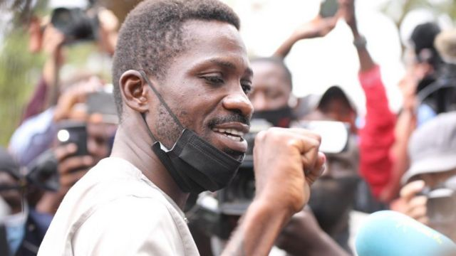 Bobi Wine greeting supporters as he voted in Kampala, Uganda - 14 January 2021