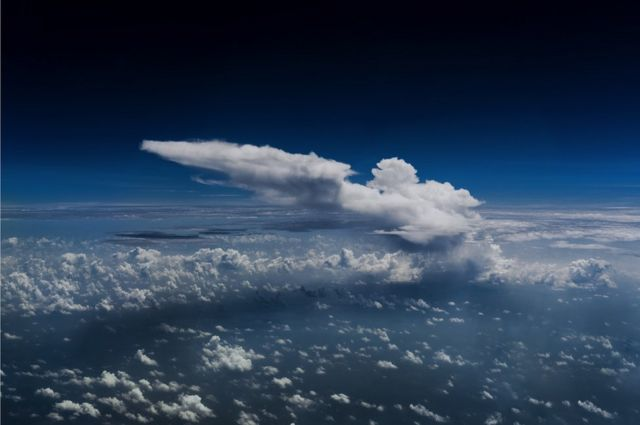 A cloud seen from a plane's cockpit