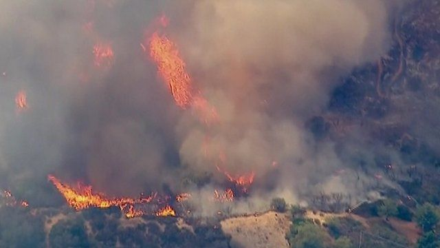Footage shows the flames spreading in Santa Clarita
