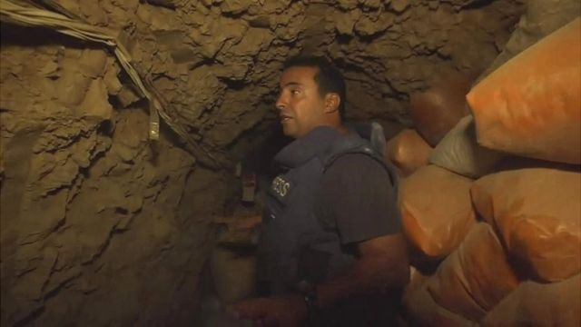 Ahmed Maher inside an underground tunnel in Mosul