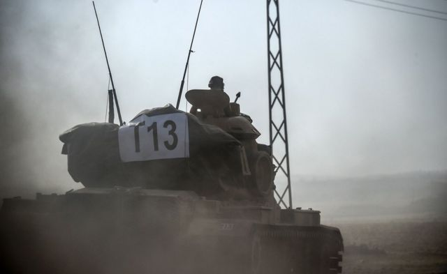 A Turkish tank heads towards the Syrian border, 24 August