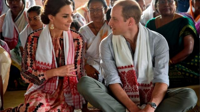 """Prince William and his wife Catherine, the Duchess of Cambridge, visit a """"Namghar"""", an Assamese site of congregational worship, in Panbari village in Kaziranga"""
