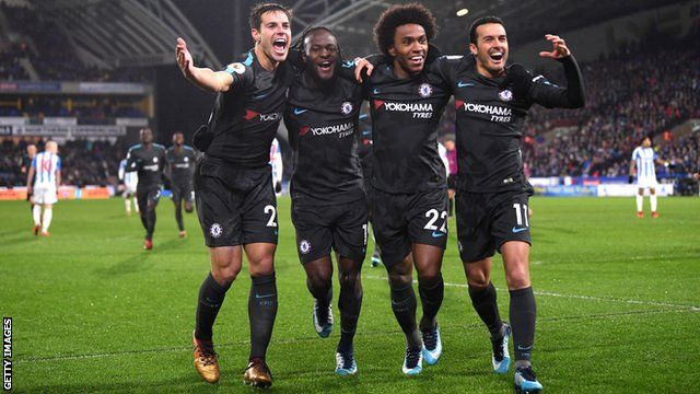Chelsea's players celebrate scoring a goal against Huddersfield