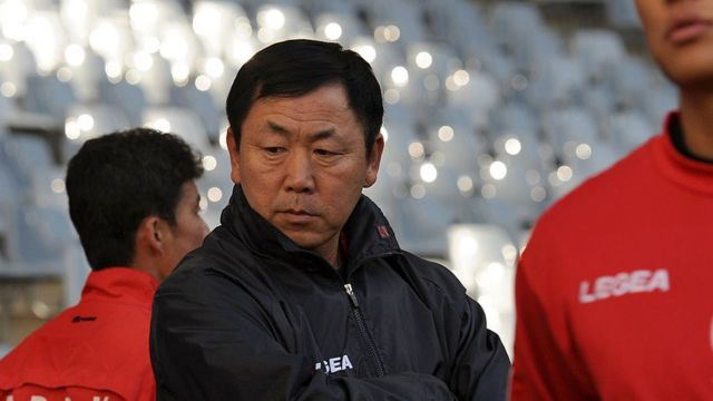 North Korea's coach Kim Jong-Hun (C) looks on as his players practice during a training session at Green Point stadium in Cape Town on June 20, 2010