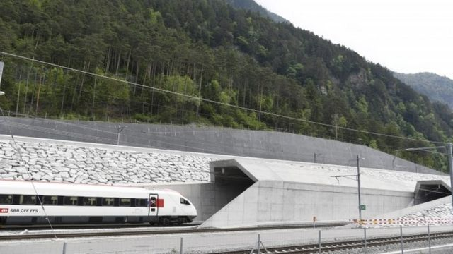 First train enters tunnel near Erstfeld, 1 June