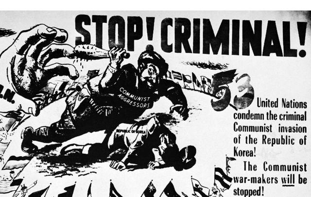 """Un cartel advierte de que las tropas de Naciones Unidas detendrán en Corea a """"los criminales comunistas""""."""