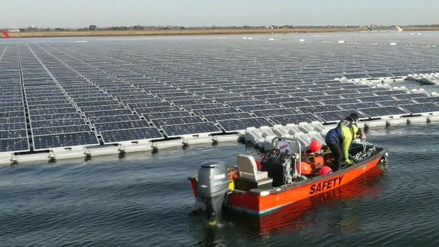 Boat at giant solar farm