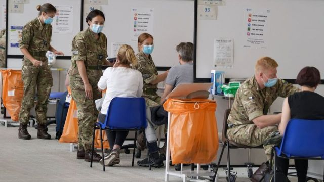 Members of the armed forces administer vaccines at the vaccination center at the Ravenscraig Regional Sports Center in Motherwell, Scotland on Friday 11 June 2021