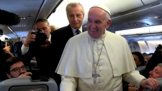 Pope Francis on board the papal plane