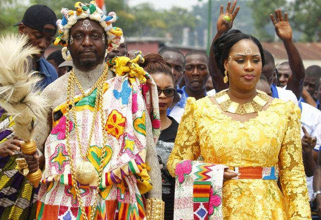 People colourfully dressed at a festival