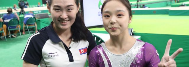 Artistic gymnasts Lee Eun-ju (R) of South Korea and Hong Un-jong of North Korea pose for a photo during the Rio 2016 Olympic Games Artistic Gymnastics events at the Rio Olympic Aren