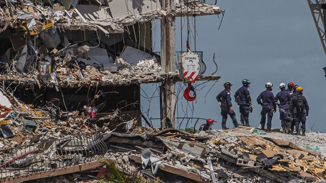 Search and rescue teams amid the rubble of the collapsed building.