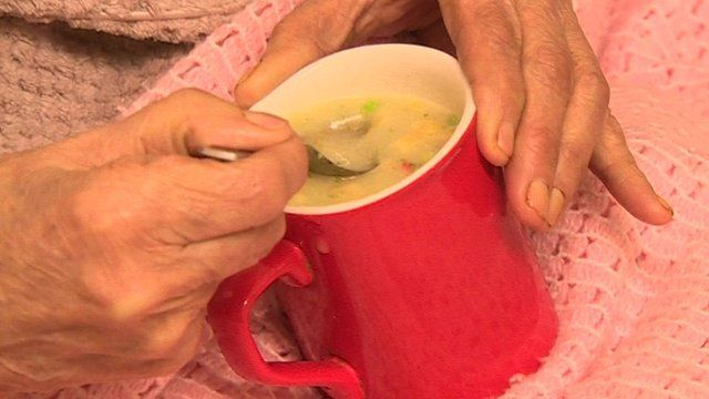 """""""Barbara"""" holding mug of soup"""