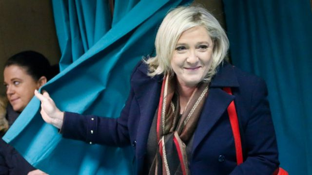 Marine Le Pen leaving a voting booth