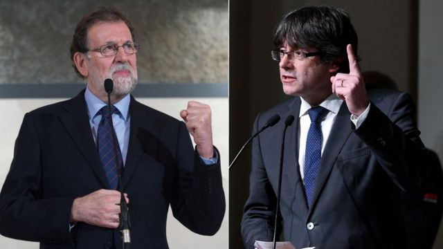 Spain's Prime Minister Mariano Rajoy (L) and Catalonia's ousted leader Carles Puigdemont (R)