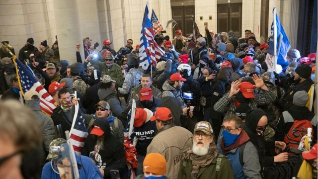 Protesters supporting Donald Trump gather near the east front door of the US Capitol after groups breached the building's security on January 6, 2021 in Washington, DC