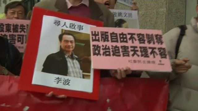 Human rights activists protest the missing booksellers