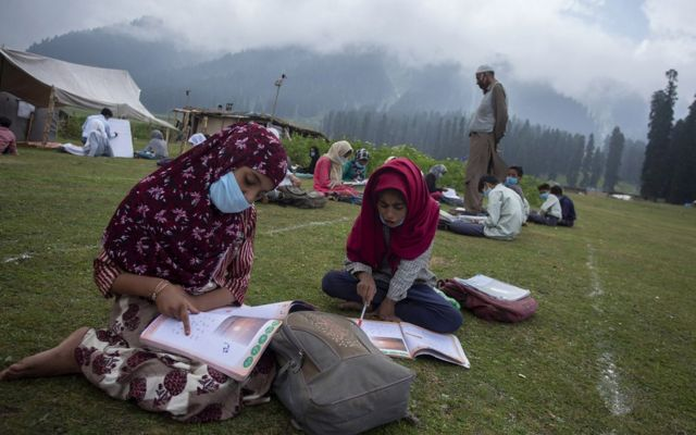 Two girls during class in Indian-administered Kashmir