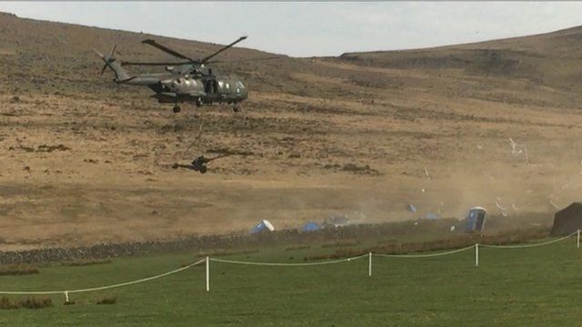 Helicopter knocking over portable toilets