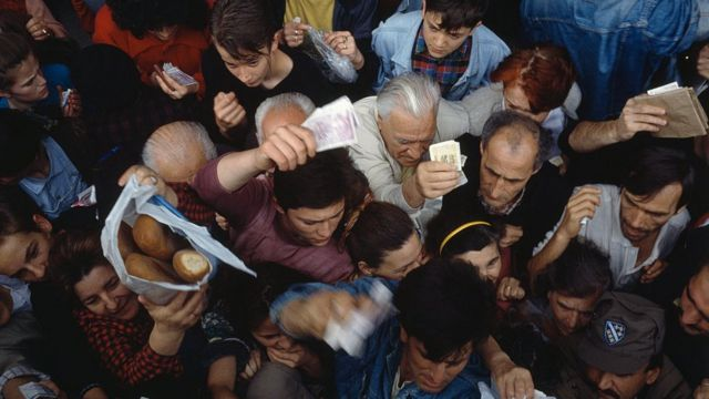 People fighting for food during the Siege of Sarajevo in the Bosnian War.