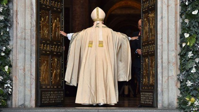 Pope Francis opens the Holy Door of St Peter's Basilica