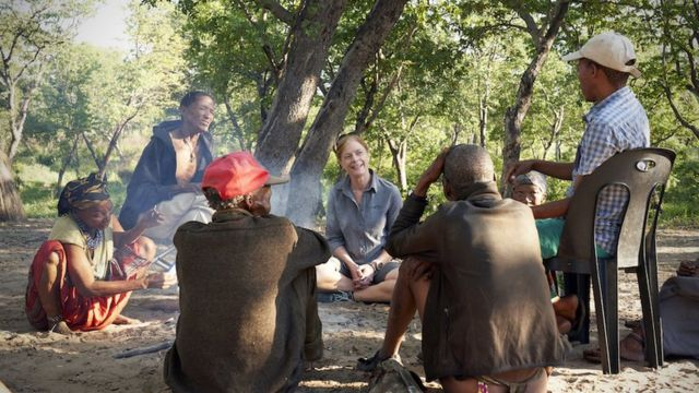 Prof Vanessa Hayes learning how to make fire with Jul'hoansi hunters in the now dried homeland of the greater Kalahari of Namibia