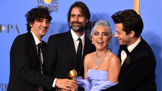Lady Gaga and (left-right) Anthony Rossomando, Andrew Wyatt and Mark Ronson with their award for best song for Shallow