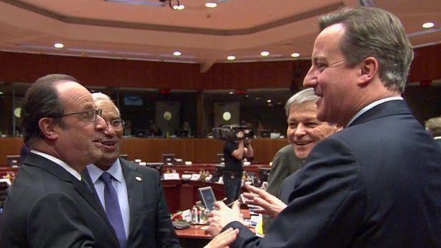 French President Hollande jokes with David Cameron