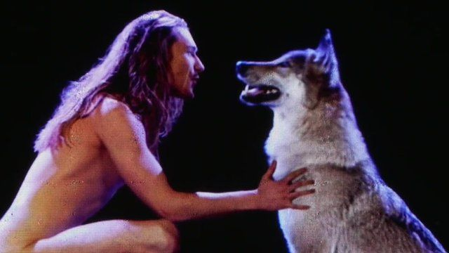 Man singing to a wolf