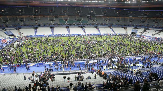 Fans on pitch at Stade de France