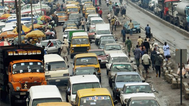 Moto dem wey dey inside traffic.