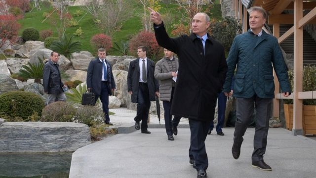 Russian President Vladimir Putin accompanied by Chief Executive of Sberbank German Gref while visiting Mria hotel in Yalta, Crimea November 23, 2018