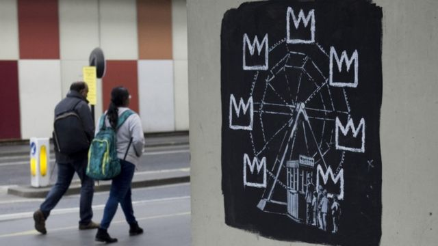 "графіті Бенксі ""Колесо огляду"""