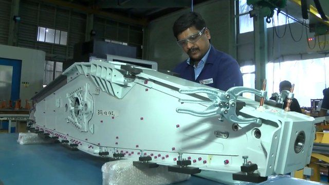 Worker in aviation factory