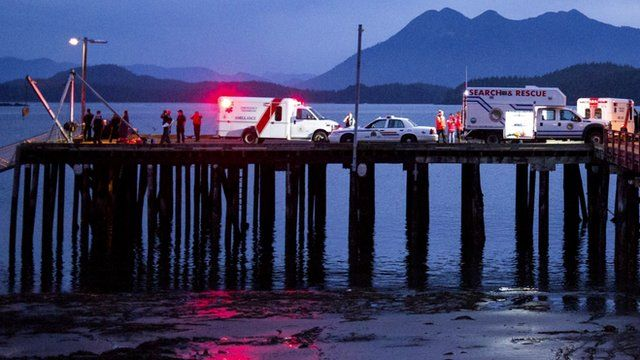 Rescue personnel mounting a search for victims of a capsized whale-watching boat park on a wharf in Tofino, British Columbia