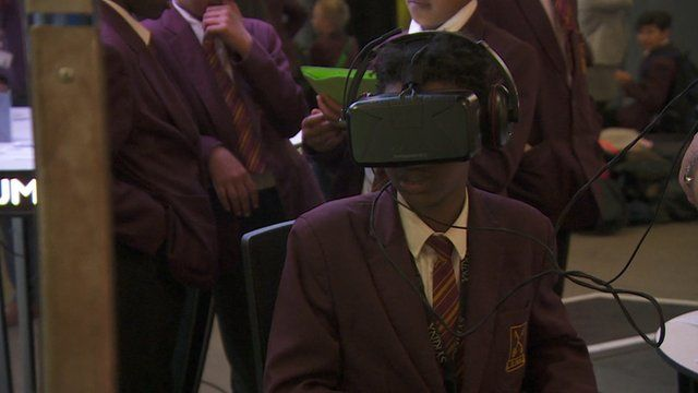 A boy uses a virtual reality headset to explore Chernobyl.