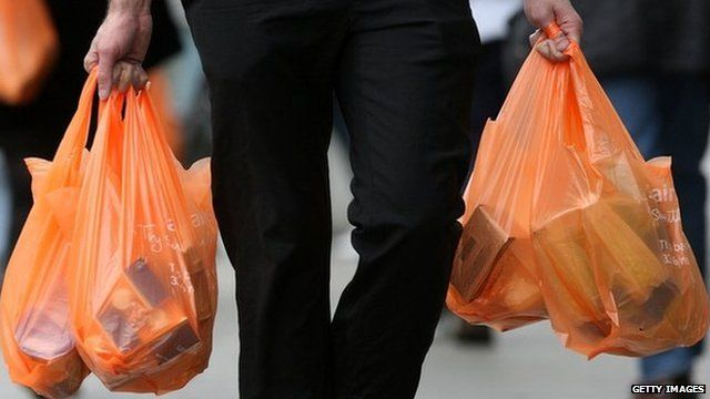 Shopper carrying plastic bags