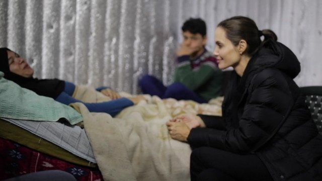 Angelina Jolie (right) visits Syrian refugees in Lebanon