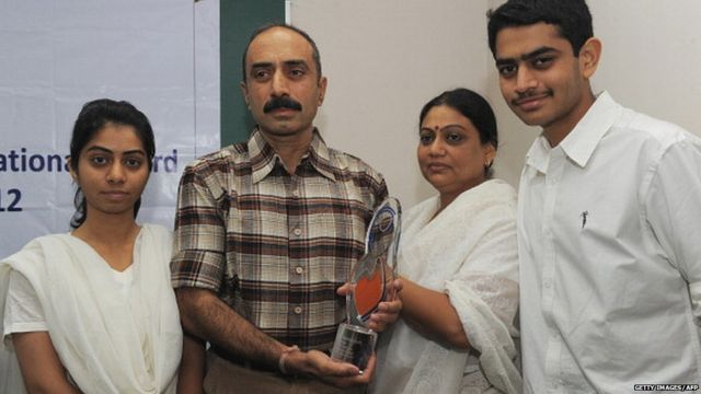 IPS Sanjiv Bhatt (2L) poses with his wife Shweta (2R), daughter Aakashi (L), and son Shantanu (R) after receiving the 5th Mother Teresa Award for Social Justice in Ahmedabad on December 31, 2012.
