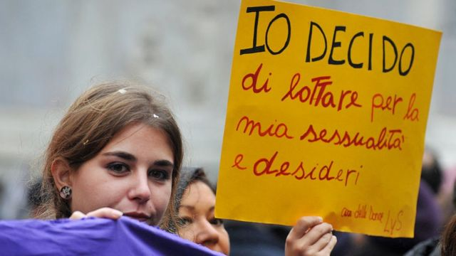 A woman holds a banner reading ''I decide'' during a demonstration in central Rome against a reform of the Spain's abortion law proposed by the conservative government on February 1 , 2014.