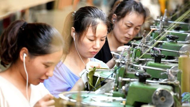 Employees working on a production line of clothes for export in China