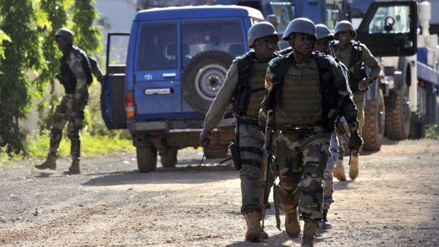 Malian troops take position outside the Radisson Blu hotel in Bamako, Mali on November 20, 2015