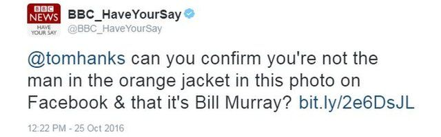 Tweet reads: @tomhanks can you confirm you're not the man in the orange jacket in this photo on Facebook & that it's Bill Murray?