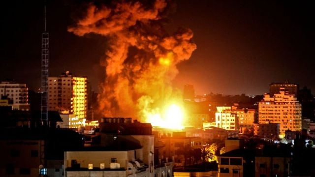 Fire and smoke rise above buildings in Gaza City
