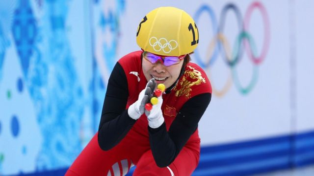 Yang Zhou of China celebrates winning the gold medal during the Ladies' 1500 m Final Short Track Speed Skating on day 8 of the Sochi 2014 Winter Olympics at the Iceberg Skating Palace on February 15, 2014 in Sochi, Russia
