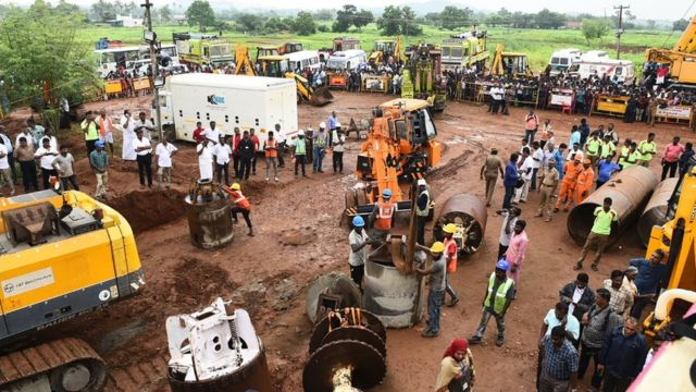 Workers digging a second well