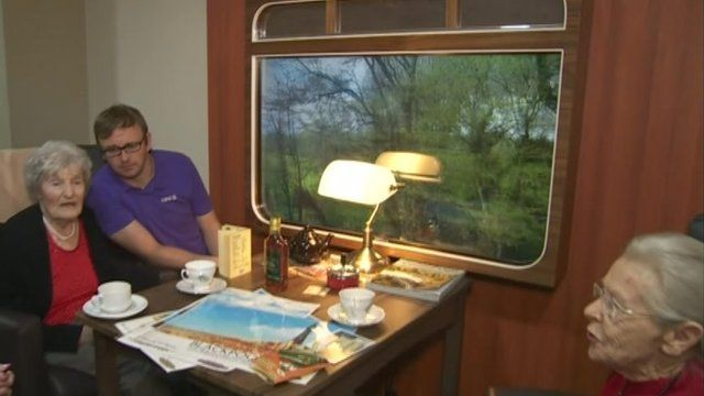 A mock-up of a vintage train carriage