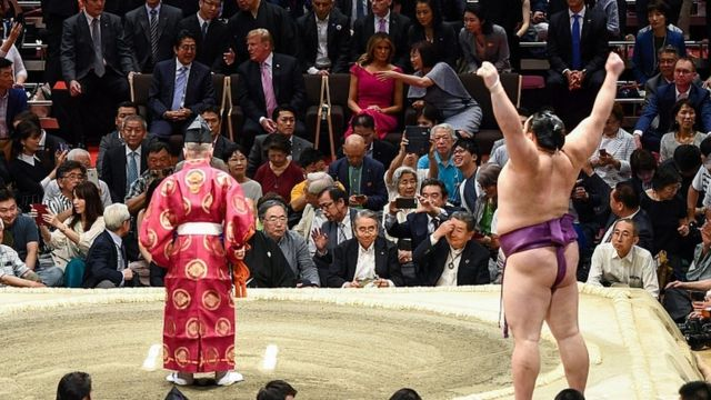 President Donald Trump watches a sumo battle during the Summer Grand Sumo Tournament in Tokyo on May 26, 2019